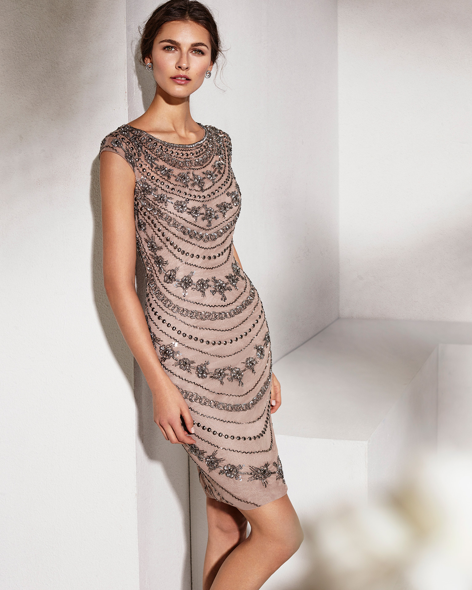 Short mikado cocktail dress with beaded lace bodice and three-quarter sleeves. Available in red, silver and cobalt.