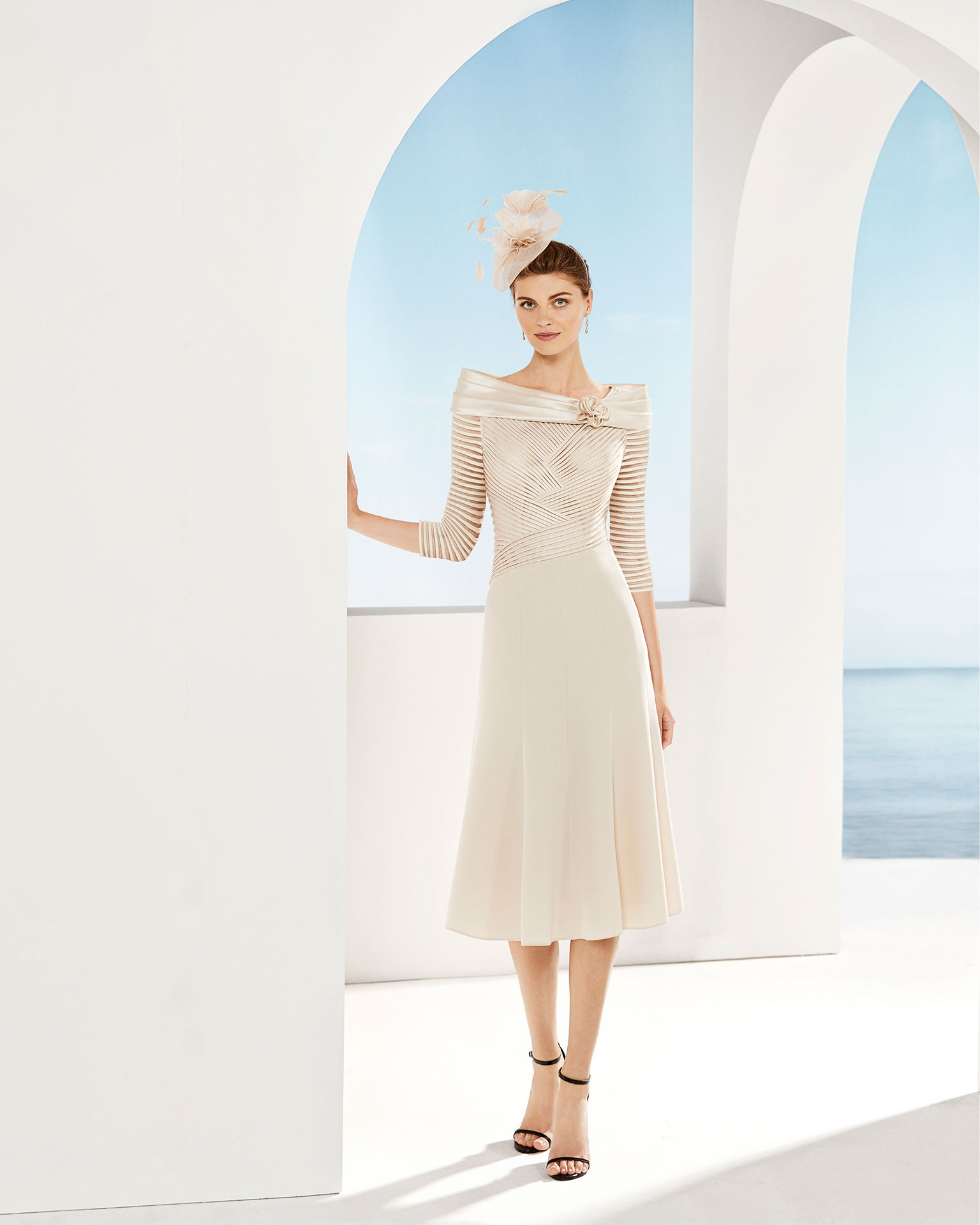 Short cocktail dress with With draped bodice, off-the-shoulder neckline and three-quarter sleeves. Available in beige and pink. 2019 COUTURE CLUB Collection.