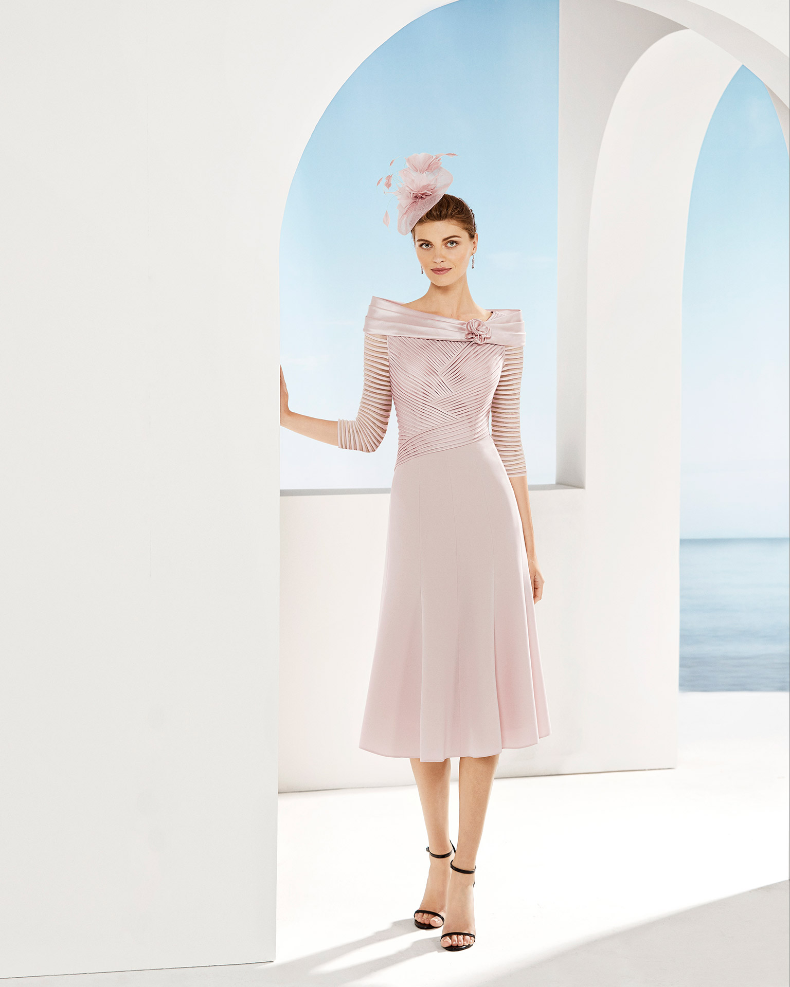 Short cocktail dress with With draped bodice, off-the-shoulder neckline and three-quarter sleeves. Available in beige and pink. 2020 COUTURE CLUB Collection.