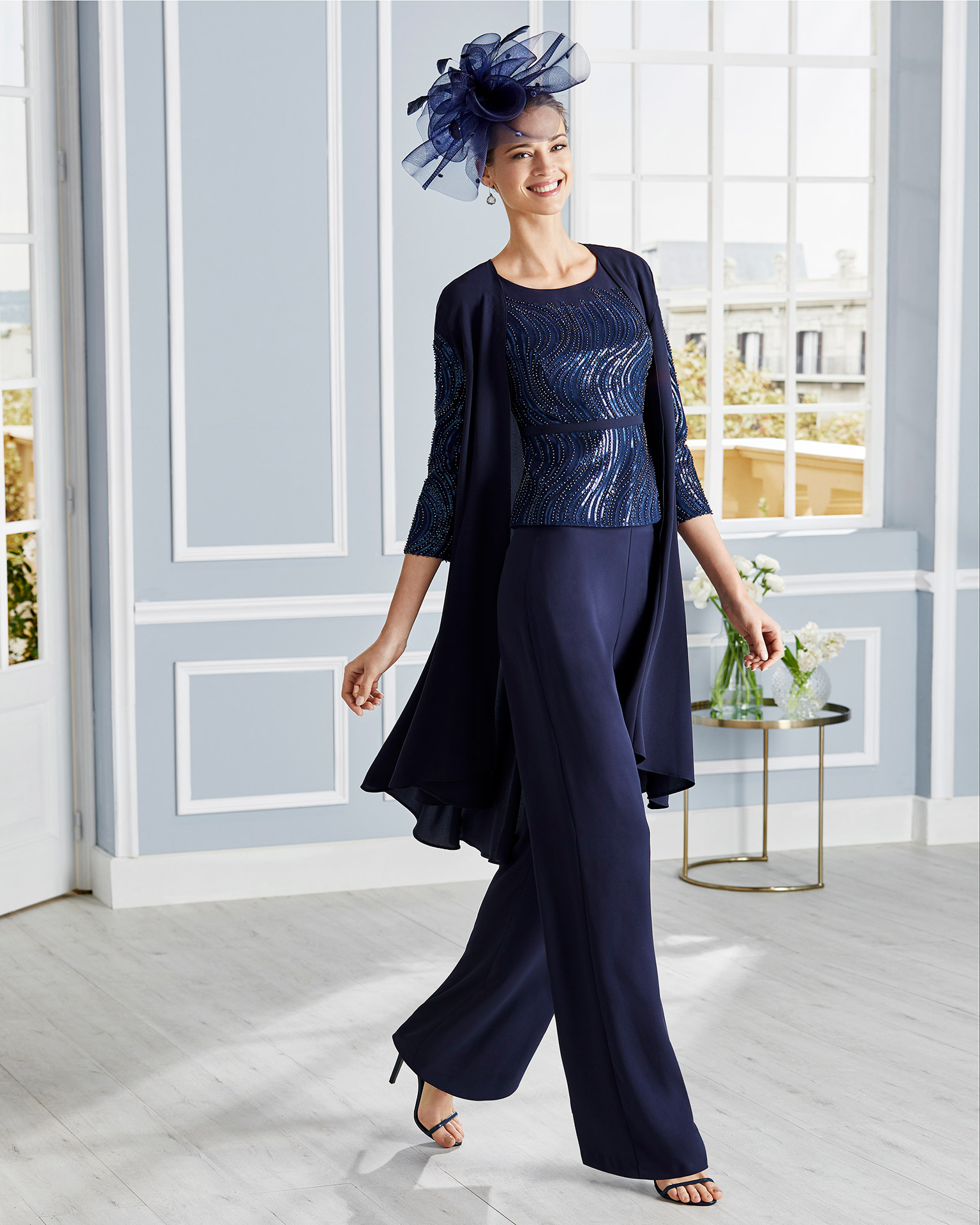 Cocktail outfit of crepe jacket with three-quarter sleeves, blouse and trousers. Beaded blouse and round neckline. Jacket in crepe Georgette. 2020 COUTURE CLUB Collection.