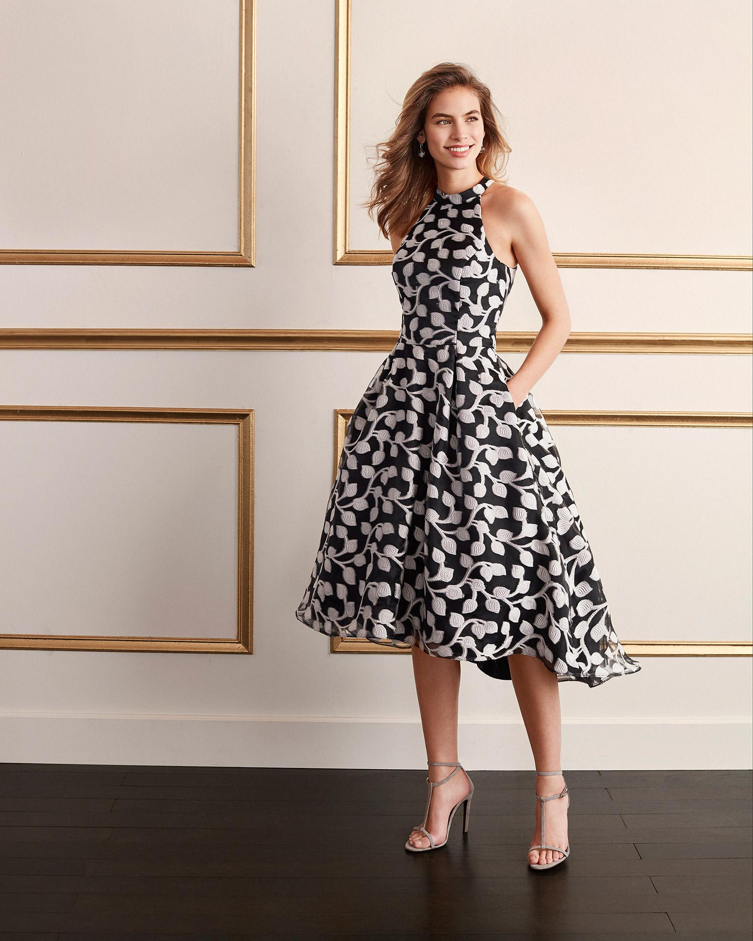 Short brocade cocktail dress. Halter neckline with asymmetrical skirt. 2020 MARFIL BARCELONA Collection.