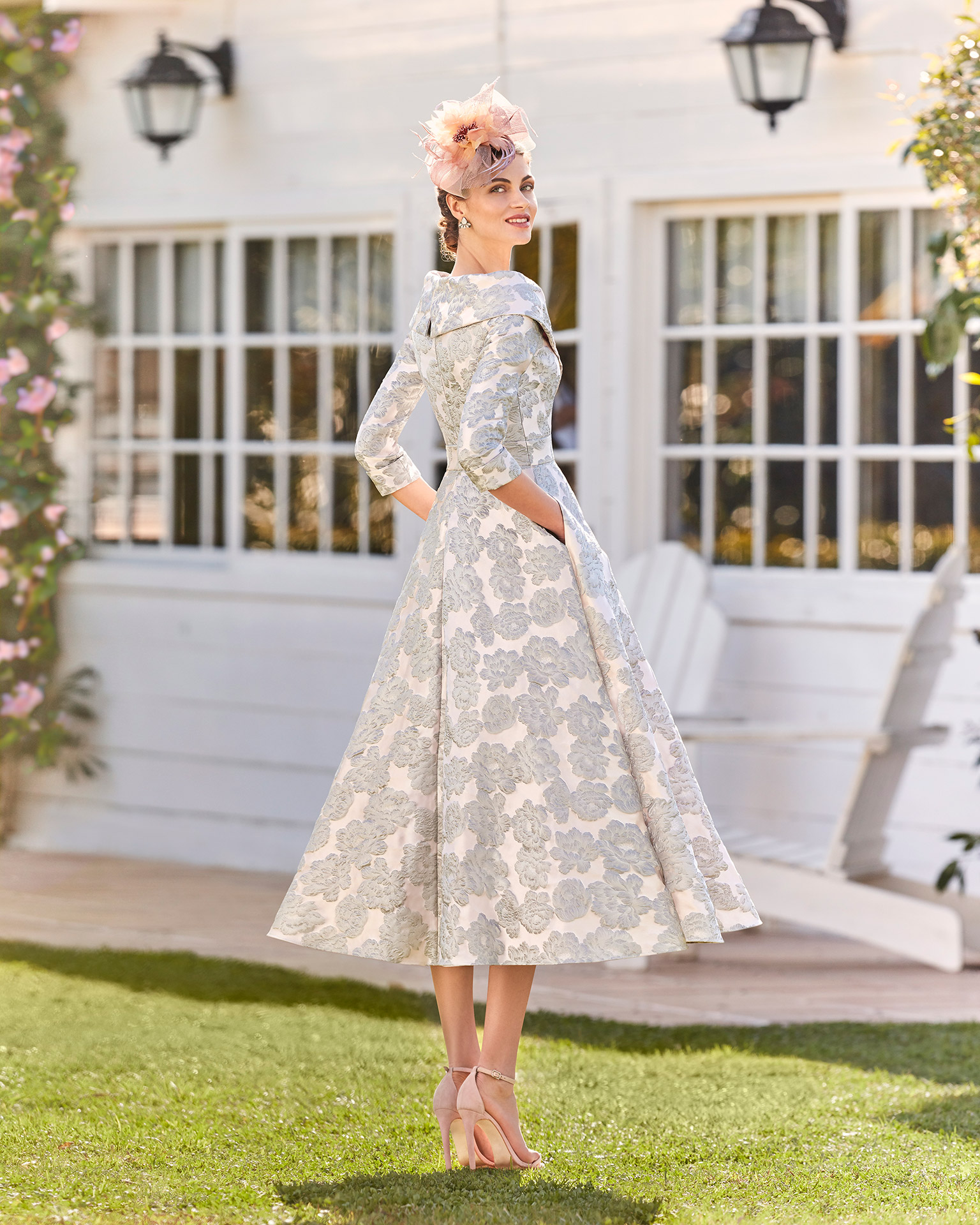 Brocade cocktail dress. Off-the-shoulder crossover neckline with three-quarter sleeves. 2021 COUTURE CLUB Collection.