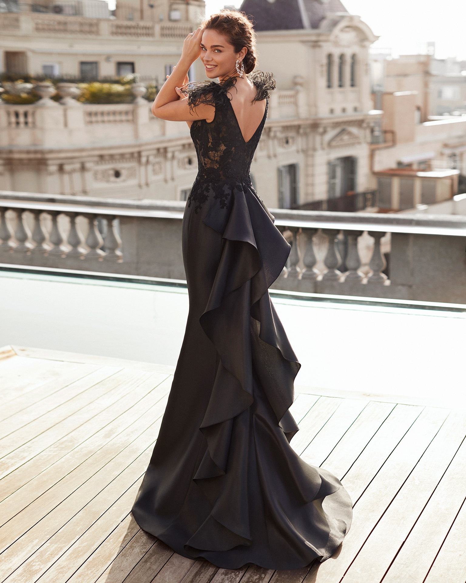 Cocktail dress in mikado with bodice in beaded lace. With V-neckline and V-back. With feathers and flower on shoulders. 2021 MARFIL BARCELONA Collection.